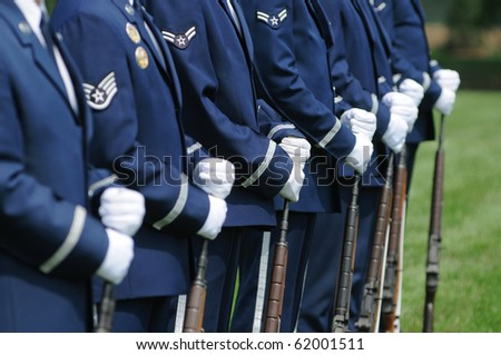 color guard squad with white gloves and rifles - stock photo