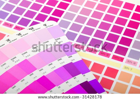 Color guide on printed color chart (purple pink and red) - stock photo