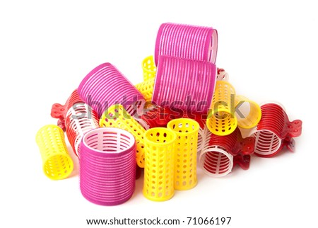 Color Hair curlers over a white background - stock photo