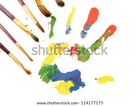 Color hand print with brushes, isolated on white - stock photo