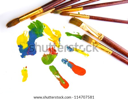 Color hand print with brushes, isolated on white