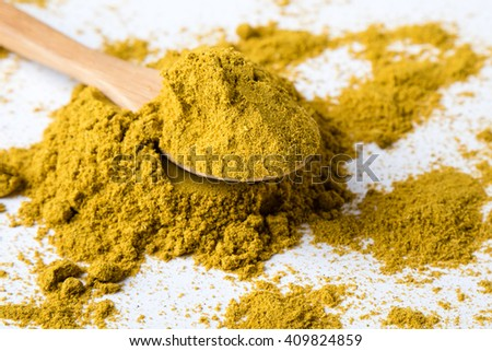color healthy curry spice on white table with spoon