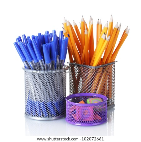 Color  holders for office supplies with them isolated on white - stock photo
