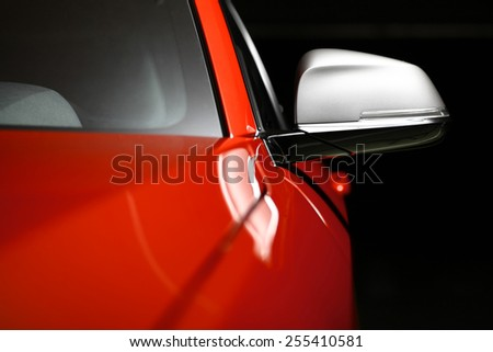 Color horizontal shot of a car's side mirror. - stock photo