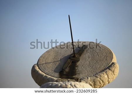 Color horizontal shot of a very old solar clock. - stock photo