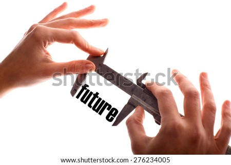 """Color horizontal shot of two hands holding a caliper and measuring the word """"future"""". - stock photo"""