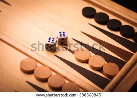 Color image of a backgammon board with dice. - stock photo
