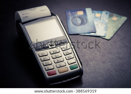 Color image of a POS and credit cards. - stock photo