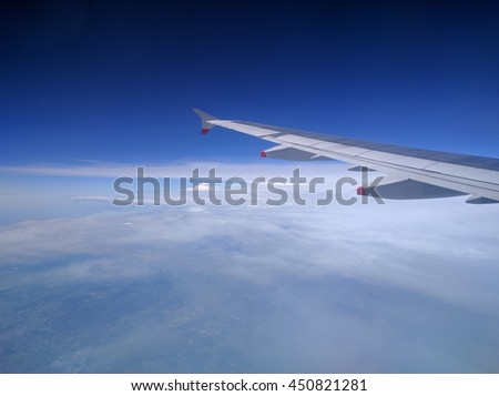 Color image of an airplane wing while flying.