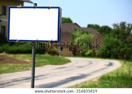Color image of an empty white sign.