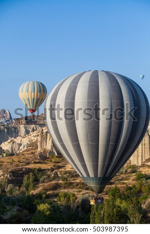 Color image of hot air balloons flying in Cappadocia, Turkey, at sunrise.