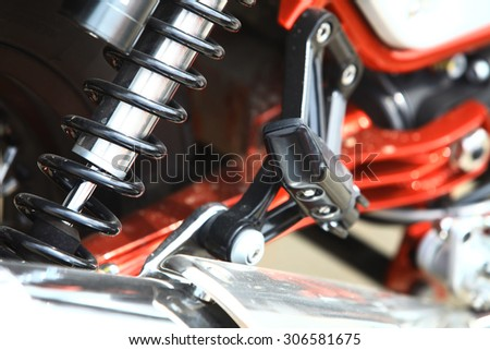Color image of the rear shock absorber of a motorcycle.