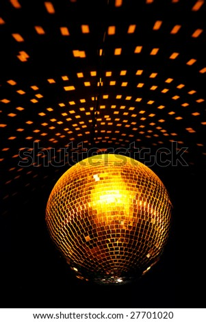 color lighting disco mirror ball in dark room - stock photo