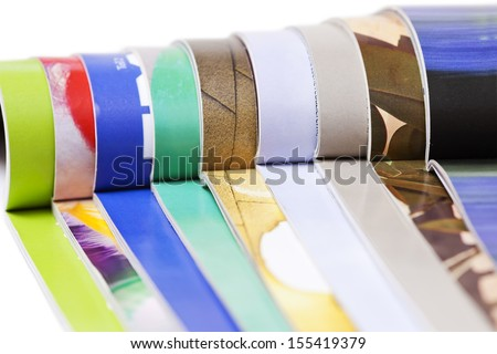 Color magazines on the white background - stock photo