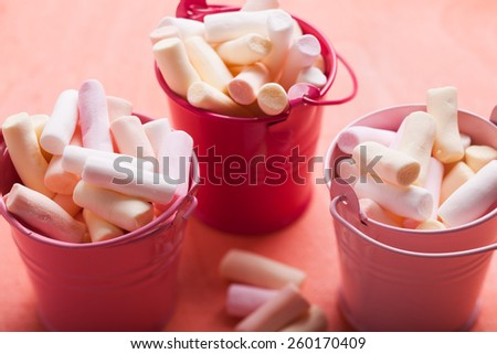 Color marshmallow in pink mini buckets - sweet compliment - stock photo