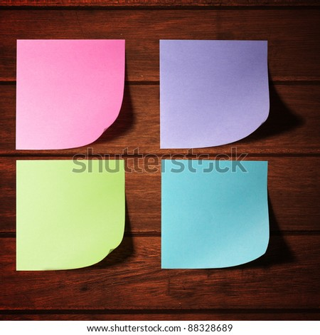 Color memo stick on the old wooden wall - stock photo