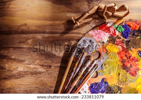 color mixing palette with brushes and mannequin - stock photo