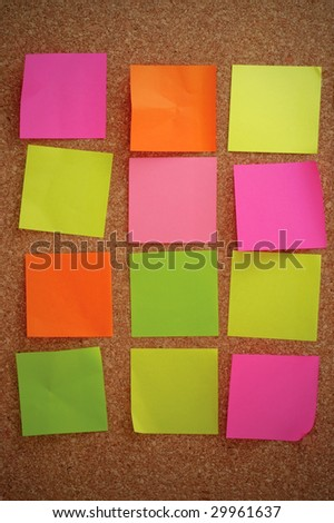 Color notes pinned to cork notice board