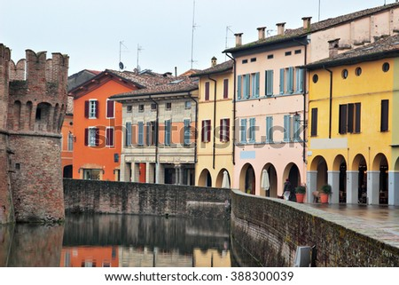 Color old houses along the moat of the castle, Fontanellato, Emilia Romagna, Italy. - stock photo