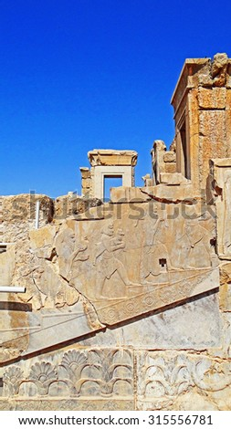 Color Painting Ancient Architectural Ruins with Ancient Persian Bas Relief Sculpture in Persepolis, Iran on Sandstone Texture - stock photo