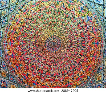 Color Painting Ancient Traditional Persian Style Mural Roof Painting at Pink Mosque in Shiraz, Iran on Sandstone Texture - stock photo