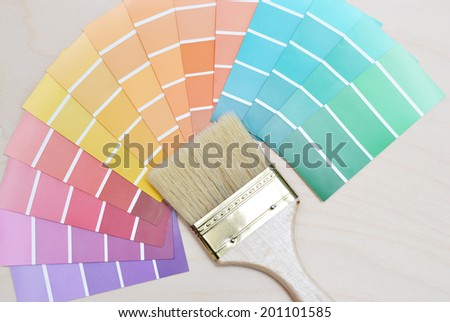 color palette and brush on a wooden background. - stock photo