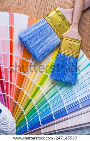 color palette and paintbrushes on wooden board - stock photo