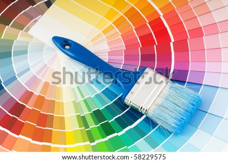 color palette guide and paint brush with blue handle - stock photo