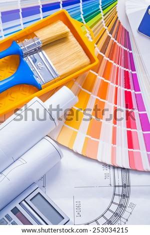 color palette paintbrushes paint can blueprints calculator  - stock photo