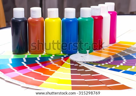 color palette, tubes of paint on white wooden background, close up - stock photo