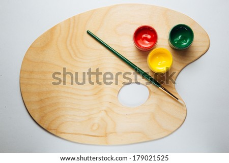 color palette with paint brush - stock photo