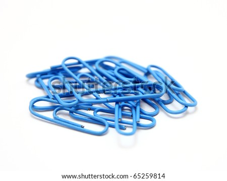 Color paper clips to background. Isolated on white background - stock photo