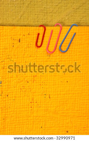 Color paper clips with handmade paper - stock photo