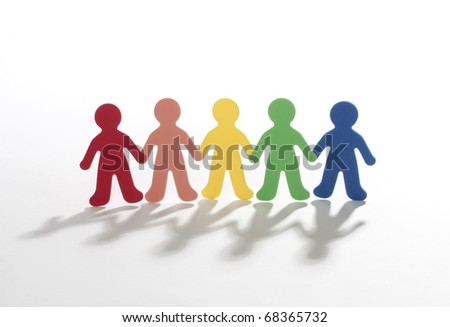 color paper people doing teamwork - stock photo