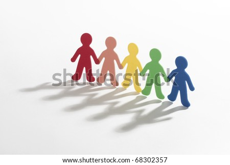 color paper people doing teamwork on white background - stock photo