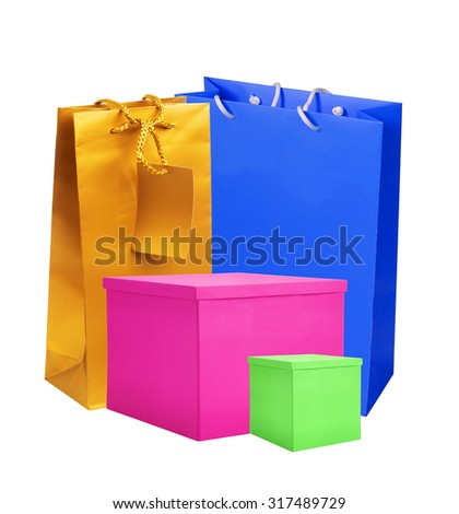 Color paper shopping bags and gift boxes isolated on white