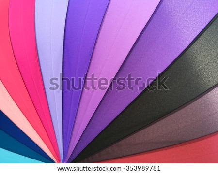 Color pattern of an umbrella background. - stock photo