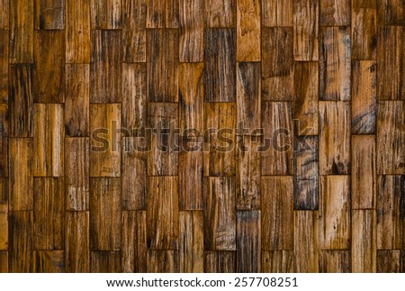 color pattern of old teak wood decorative surface on wall - stock photo