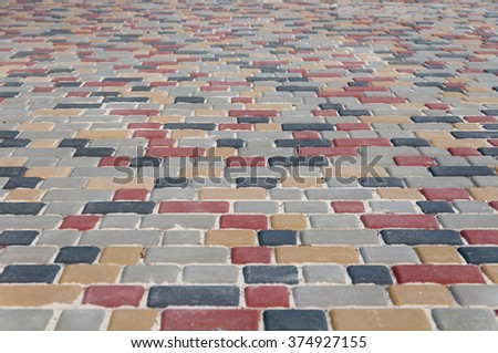 color paving slabs extending to the horizon in the background - stock photo