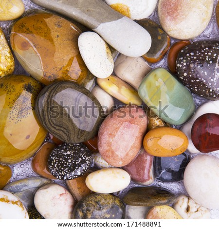 Color pebble stone in background - stock photo