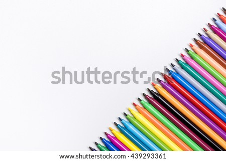 Color Pen on Rough White Background or Wallpaper Copy Space in The Left Side from Top View - stock photo