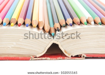 Color pencil and dictionary