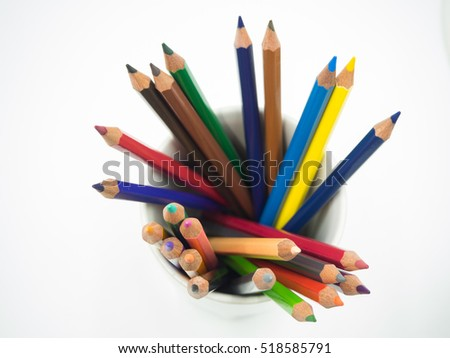 Color pencil in pot on white background, top view