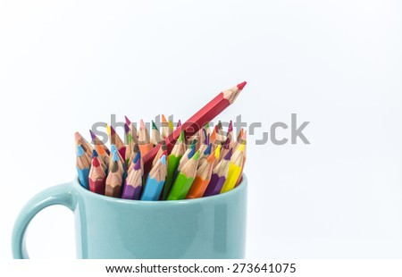 Color pencil in the cup on white background - stock photo
