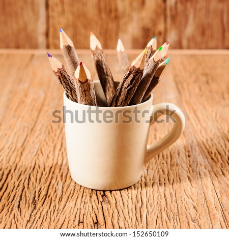 color pencil made of branches in coffee cup - stock photo