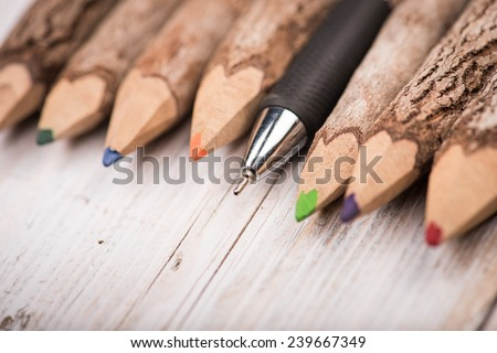 color pencil made of branches with one pen on wood table - stock photo