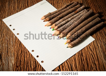 color pencil made of branches with paper - stock photo