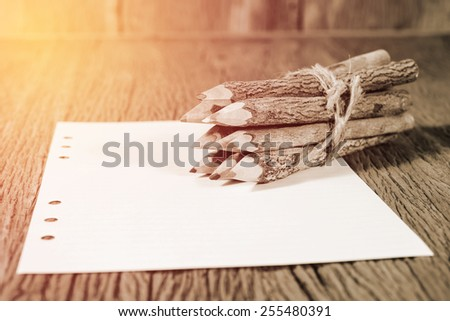 color pencil made of branches with paper : lighting effect vintage style - stock photo