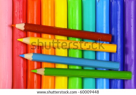 color pencil on toy clay - stock photo