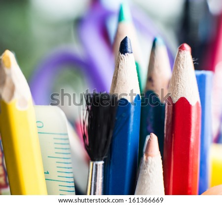 Color pencils and brush close-up - stock photo